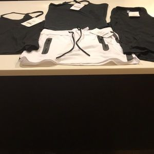Fabletics set of 3 tops and a skirt